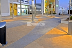 The interior checkerboard pattern on this decorative concrete paving was inspired by the racetrack infield at nearby Daytona International Speedway and the utilization of Bomanite Integral Color to create the two-tone coloration will provide longevity and durability of color.