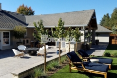 Bomanite Sand Color Hardener and Bomanite French Gray Release Agent were used here to intensify the stamped texture of this Bomacron English Slate imprinted concrete and unify the design in this backyard retreat.