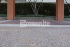 Bomanite Bomacron English Sidewalk Slate imprinted concrete was installed here with a Bomanite Sandscape Texture Exposed Aggregate finish to create a hardscape surface that wears well and is easy to maintain while providing a durable and decorative finish.