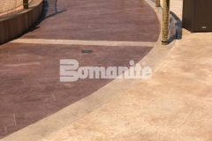 Bomanite Imprint Systems were used here to create this stunning, stamped concrete hardscape, including this Bomacron Boardwalk pattern that resembles wood planking, and adds distinctively beautiful design detail to this outdoor space.
