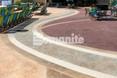 This stamped concrete surface was created using Bomanite Imprint Systems and features multiple Bomacron patterns including Garden Stone, Boardwalk, Sandstone Texture, and Slate Texture that come together perfectly to add impeccable and distinctive design detail to this decorative concrete hardscape.