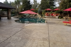 This expansive backyard pool deck and patio were cast-in-place and stamped with the Bomacron Slate Texture imprint pattern and the use of Bomanite Sand Color Hardener and Bomanite Light Brown Release Agent were perfect to enhance the natural design aesthetic in this backyard retreat.