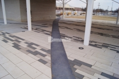 Bomanite Sandstone stamped concrete was installed at Redbud Festival Park in Owasso, Oklahoma to create a pavilion area with accent borders that create definition around the concrete pavers and add beautiful detail to the overall design aesthetic.