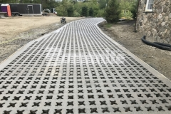 Bomanite Grasscrete was utilized here to create a pervious concrete driveway that will mitigate drainage issues while maintaining strong structural integrity so that vehicles can access the tradesmen estate entrance at this residence.