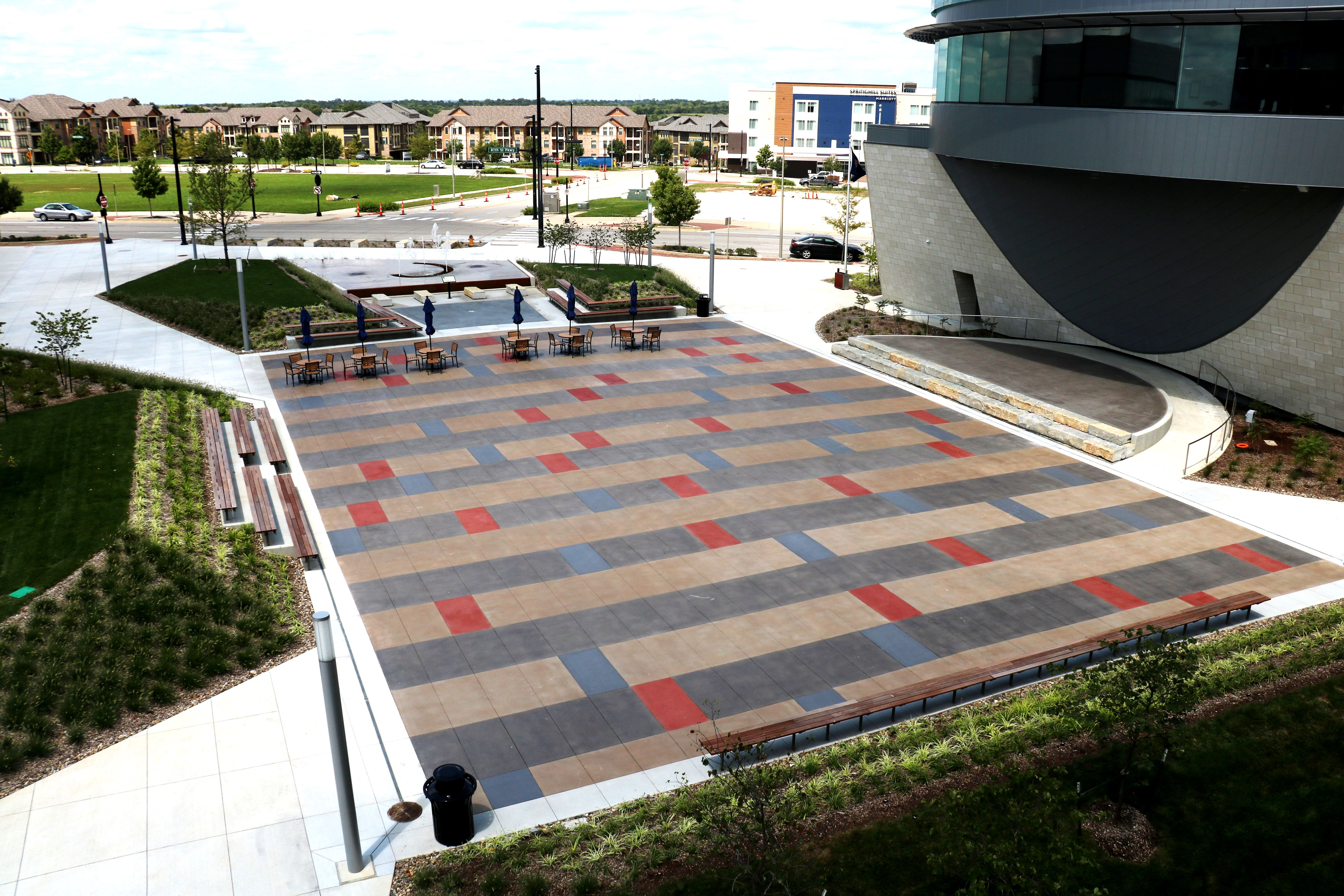 Bomanite Sandscape Texture with Bomanite Con-Color is featured at the Lenexa Civic Center Festival Plaza and Bomanite Alloy at the Hist