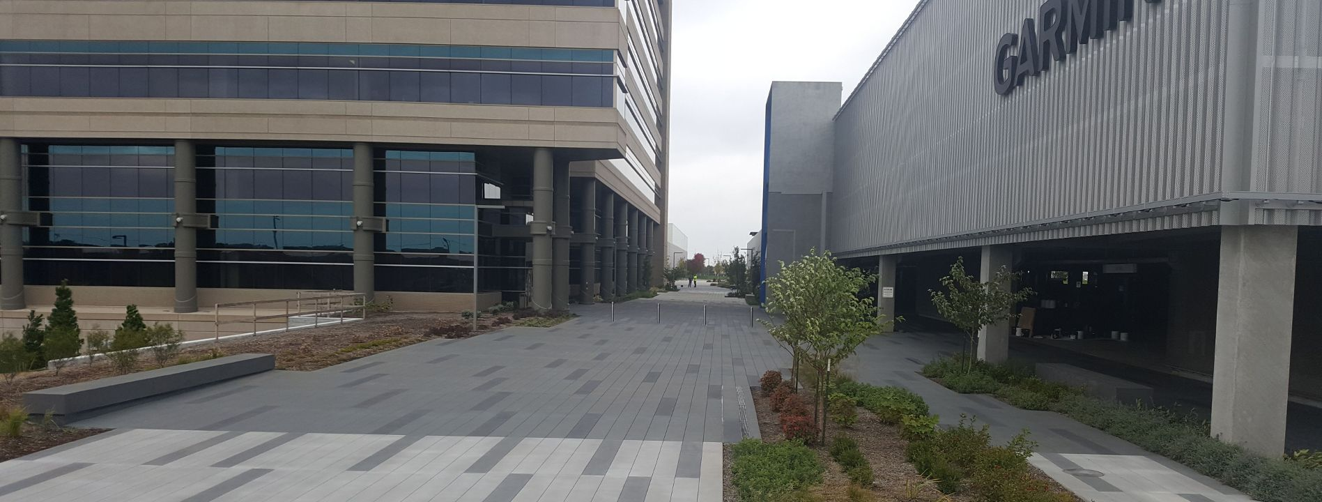 Beautiful decorative concrete at the Garmin Expansion Pedestrian Plaza using Bomanite Exposed Aggregate Systems with Bomanite Sandscape Texture in Olathe, KS.