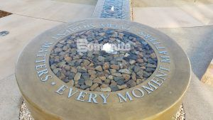 "Close up of the brass words ""Every Moment Matters"" in the fountain created with Bomanite decorative concrete at the Clovis Medical Center housing the Clovis Cancer Institute."