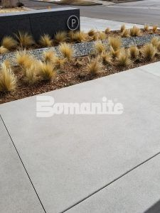 Drought resistant vegitation was used at the 50 Fifty DTC building in the Denver Tech Center that features Bomanite Sandscape Refined Exposed Aggregate decorative concrete installed by Colorado Hardscapes which helped achieve a Gold LEED certification.