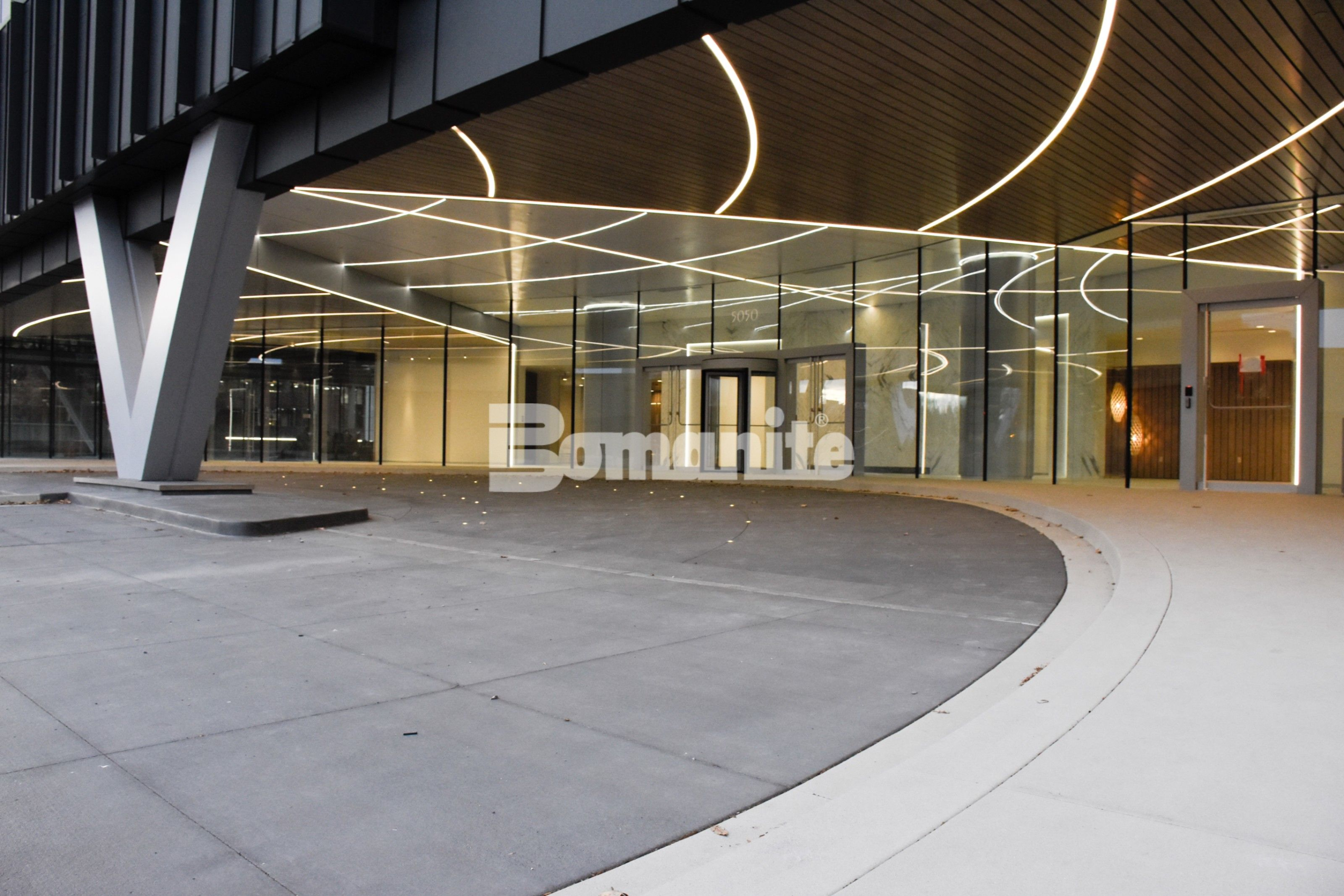 Porte cochere of the 50 Fifty DTC building incorporates Bomanite Sandscape Refined Exposed Aggregate for the decorative concrete curbs and walkways as well and was installed by Colorado Hardscapes in Denver, CO to bring the Nautical Design to life.