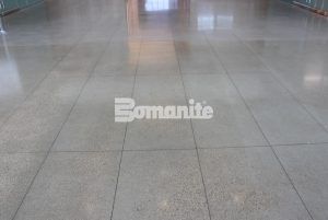 Long view of the lobby flooring using Bomanite VitraFlor Custom Polishing Decorative Concrete installed by Texas Bomanite in the lobby of the Cypress Waters Office Complex located in Coppel, Texas.