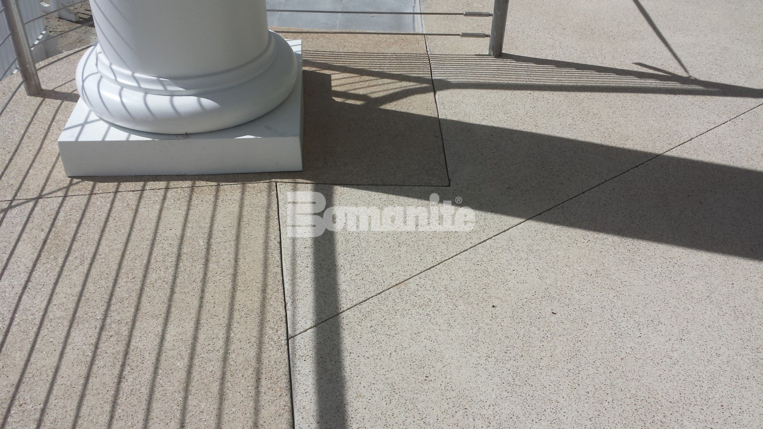 Close up of column and Bomanite Revealed Exposed Aggregate Systems decorative concrete installed at Westchester CC Beach Club by Beyond Concrete of Keyport, NJ.