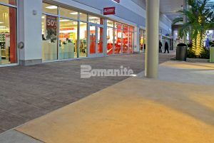 Store Fronts view with Bomanite Imprint Systems Bomacron Boardwalk Pattern Used in Store Front Walkway at the Tanger Outlets in Daytona, FL, installed by Bomanite Licensee Edwards Concrete located in Winter Gardens, FL.