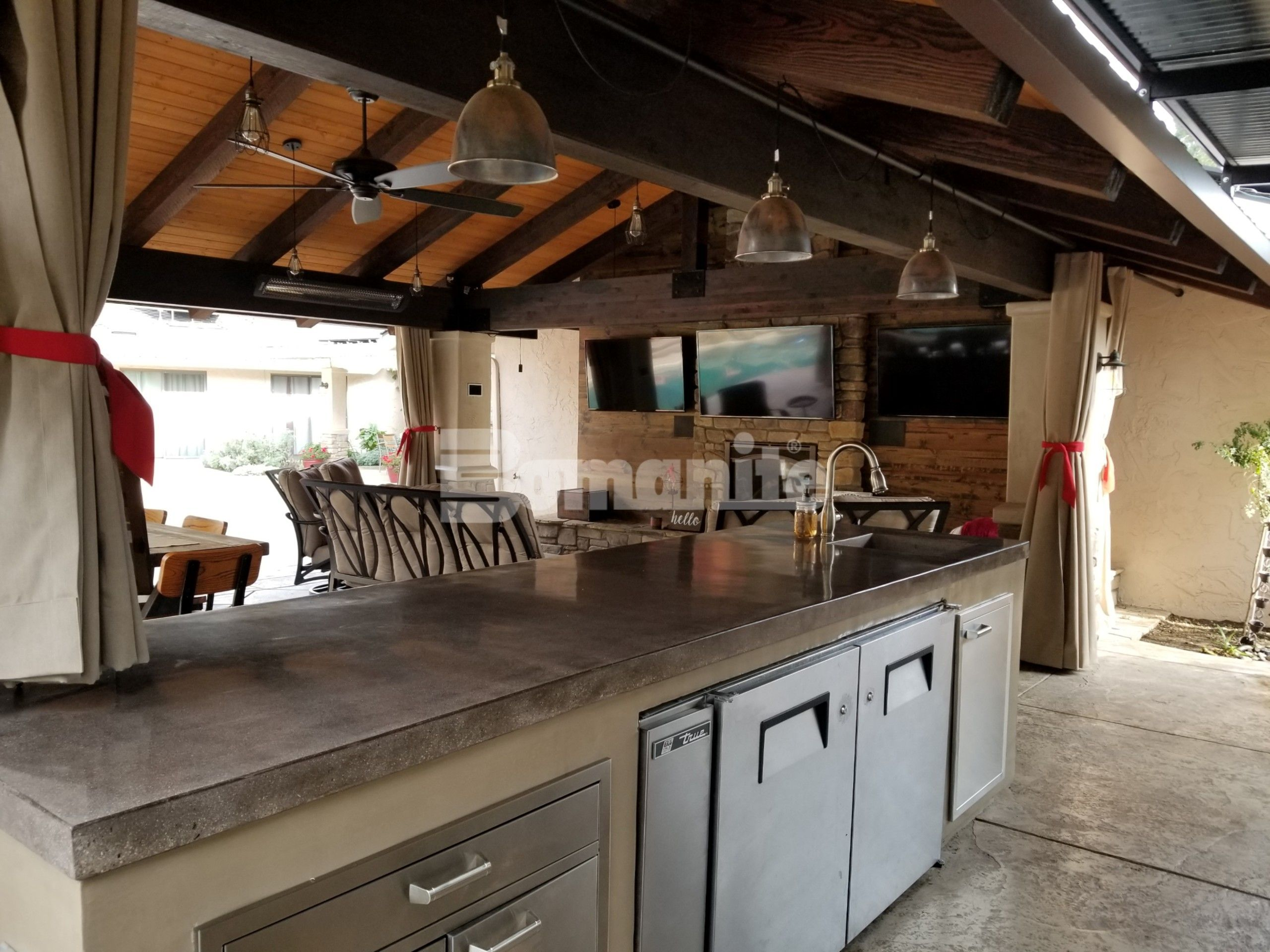 Cabana at a private residence featuring a Bomanite Custom Polished decorative concrete countertop and flooring using the Bomanite Antico Process in Fresno, CA, installed by Heritage Bomanite.